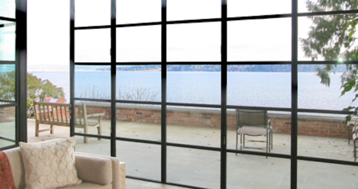 Window wall, out-swing door, lake view, sun room, muntin grids, steel windows and doors