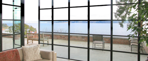 Window wall | out-swing door | lake view | sun room | muntin grids | steel windows and doors