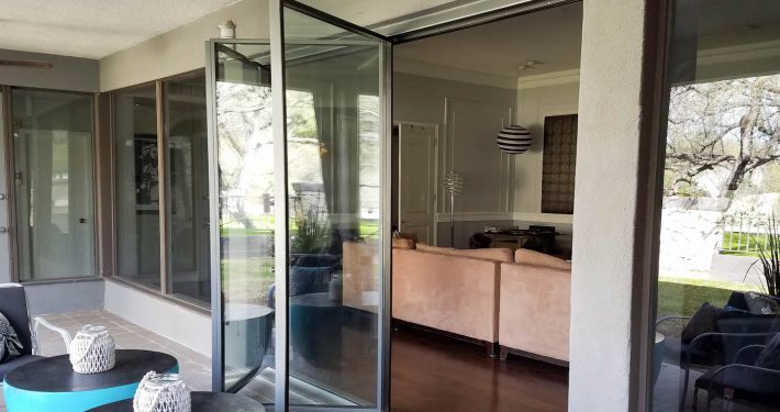 Exterior view of a partially opened three panel 2Fold® door