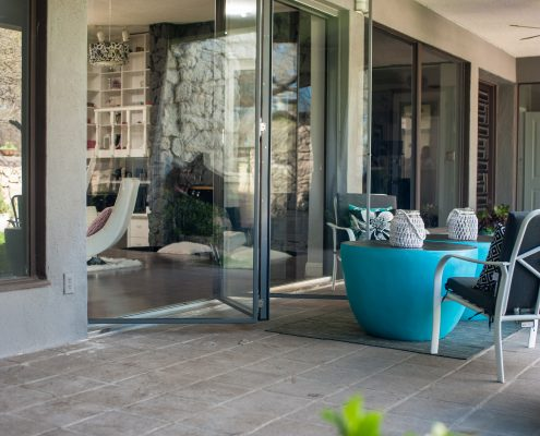 Exterior view Bi-fold three panel door partially opened made by 2Fold®