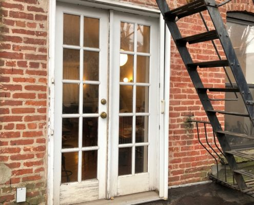 old french door system to be replaced. folding door space predecessor.