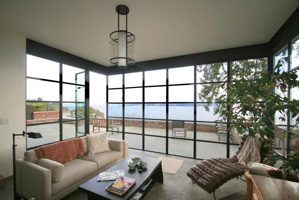 Interior window wall | out-swing door | lake view