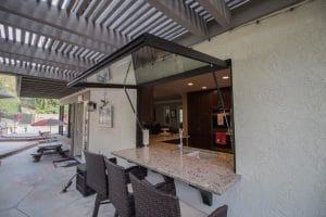 This opened Pass Through window shows its functionality for an indoor/outdoor living space.